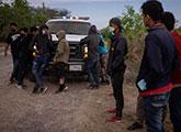 Unaccompanied child migrants from Central America await transportation to U.S. Border Patrol processing facility